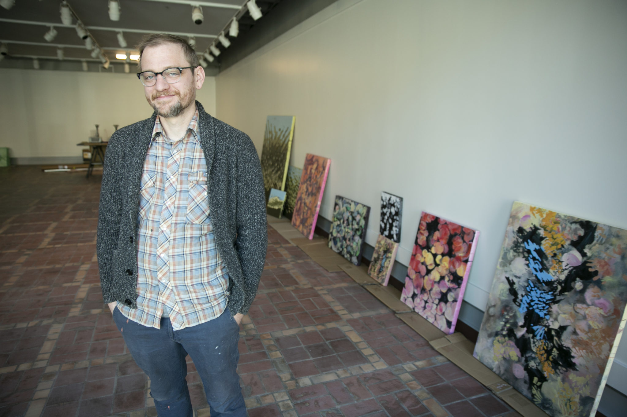 Ben Dunn is pictured in an art gallery