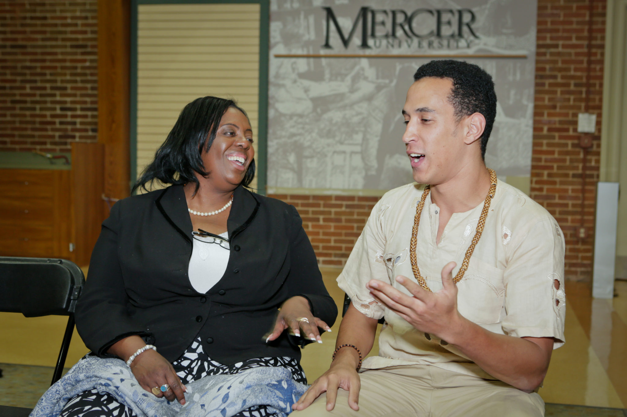 2012 Honorable Amina Salum Ali, African Union Ambassador engages with a student.