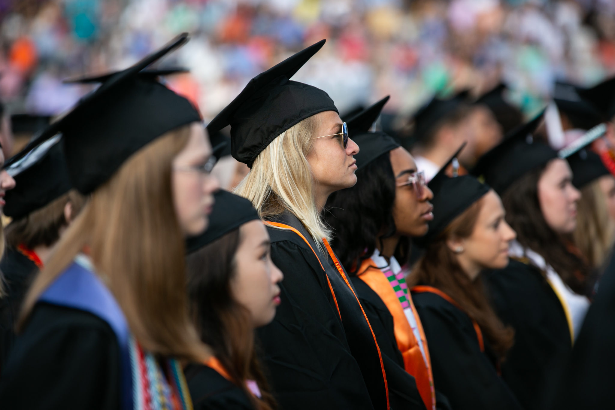 Students wearing caps and gowns at commencement
