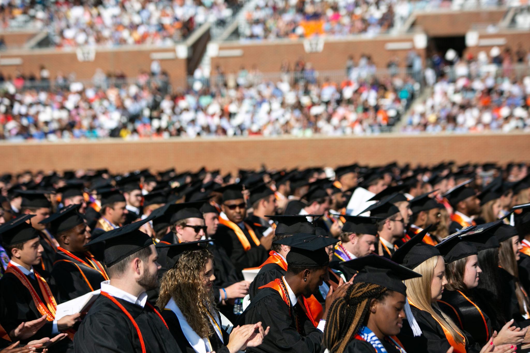 Graduates sit at 2019 Macon commencement.