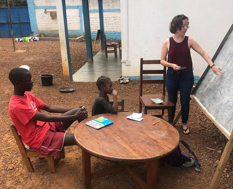 French major Sarah Harris, right, tutors children at Home of Hope orphanage in Guinea for her internship in spring 2019.