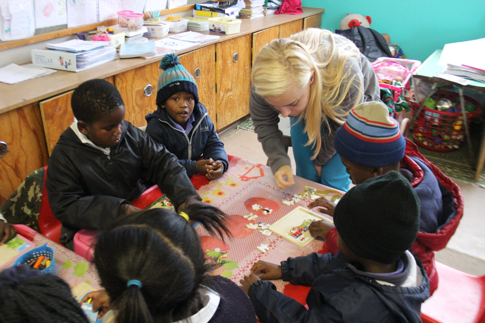 A Mercer student works with children in South Africa.