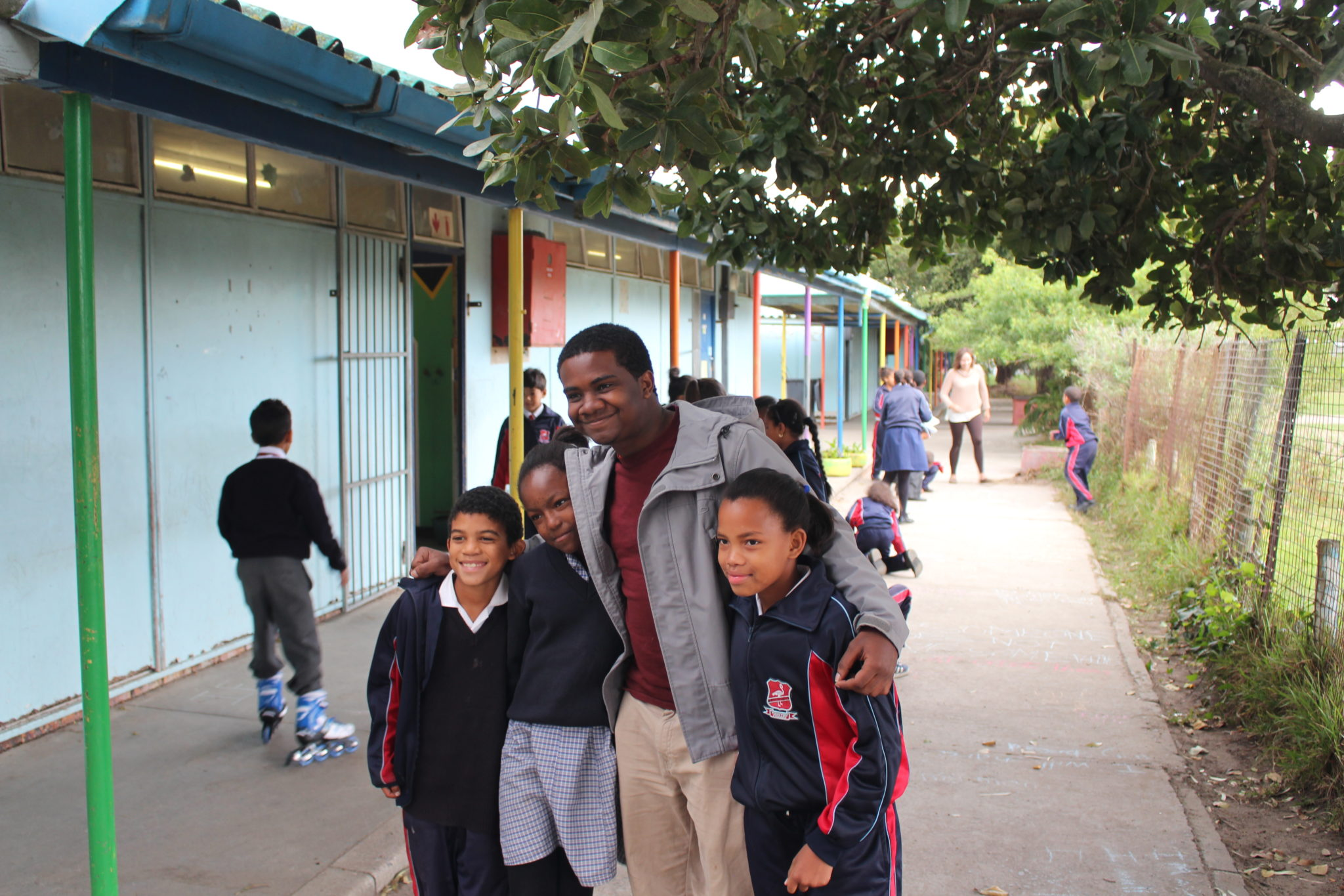 A Mercer student is pictured with two local kids on Mercer On Mission in South Africa.