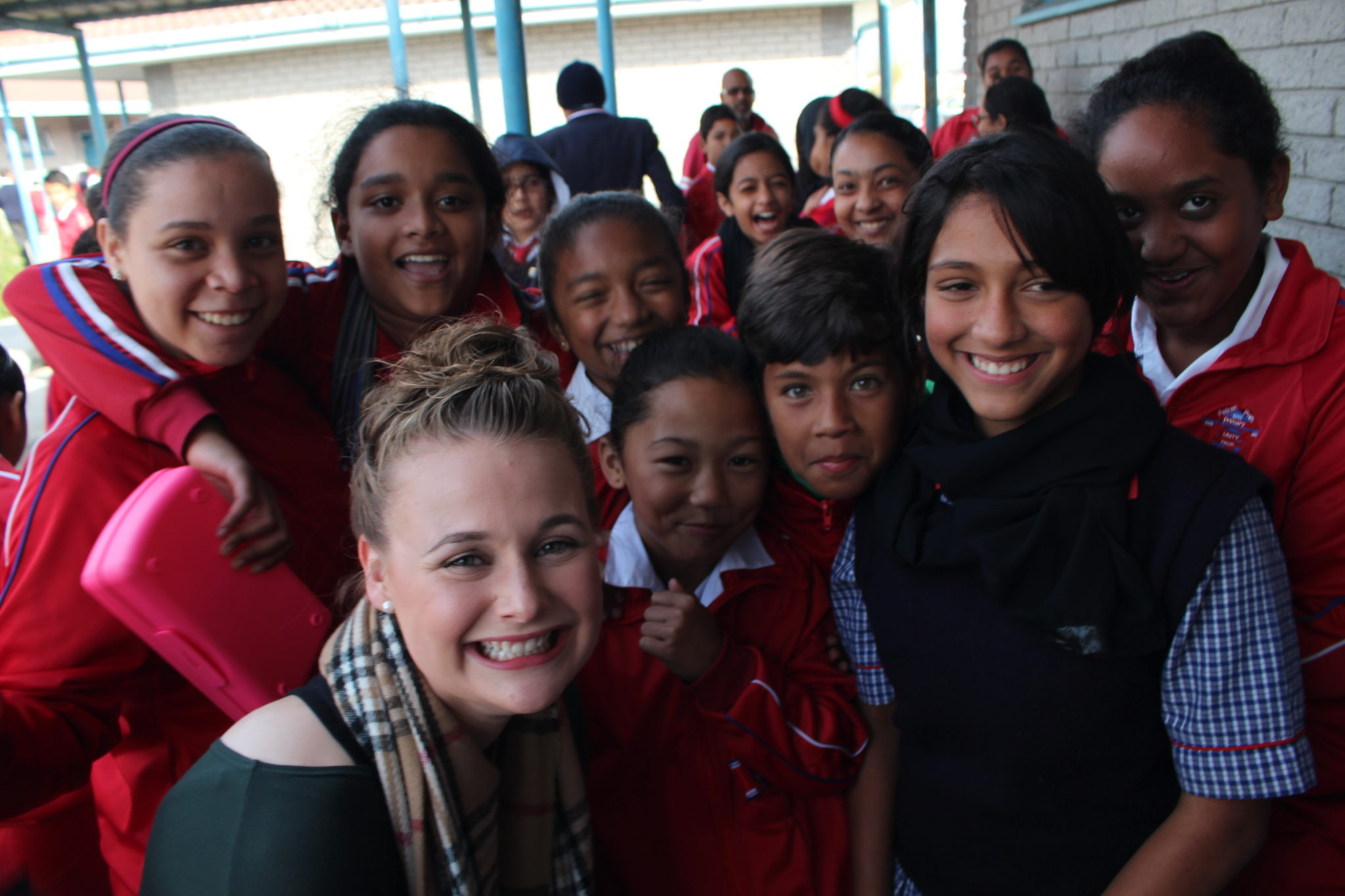 A Mercer student is pictured with local students during a Mercer on Mission trip to South Africa.