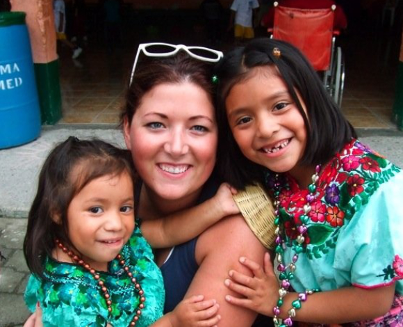 A student with two children during Mercer On Mission in Guatemala.