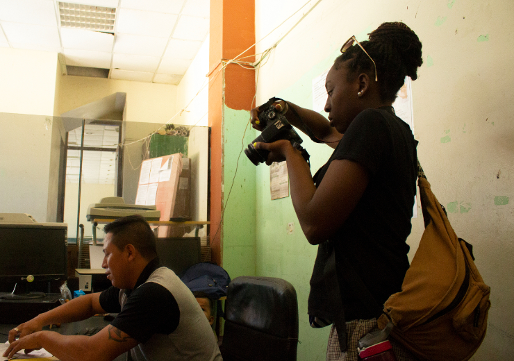 A student takes photos on a Mercer On Mission trip to Peru
