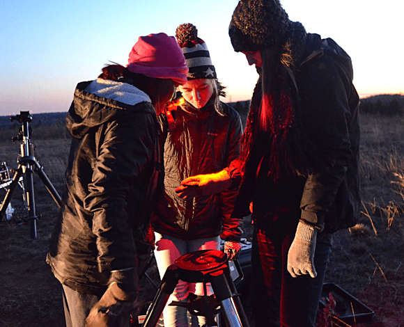 Students in Dr. Matt Marone's astronomy (Physics 115) class set up their telescope during an outdoor lab class on Jan. 31, 2019.