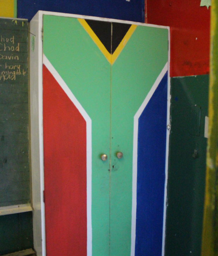 The South African flag is painted on a cabinet in a classroom in South Africa.