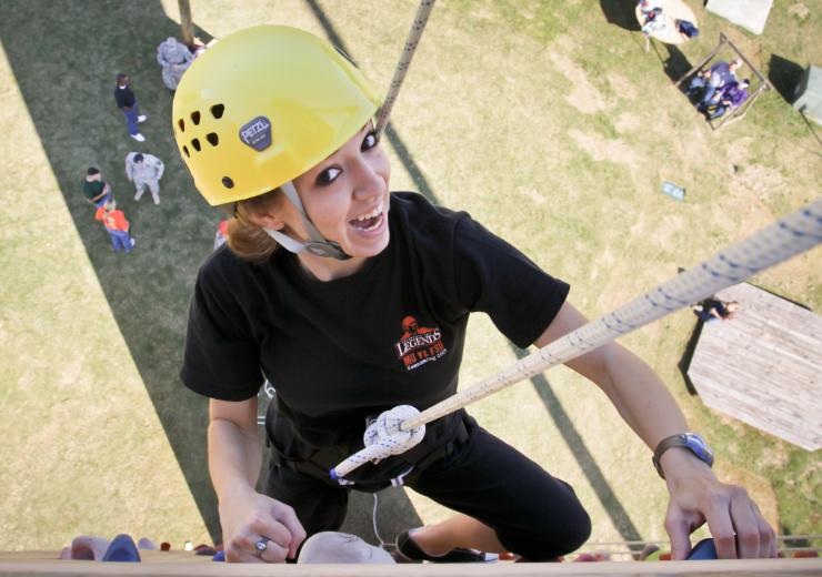 A cadet climbs a rock wall