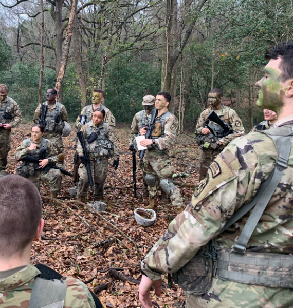 ROTC cadets wear camo in the woods