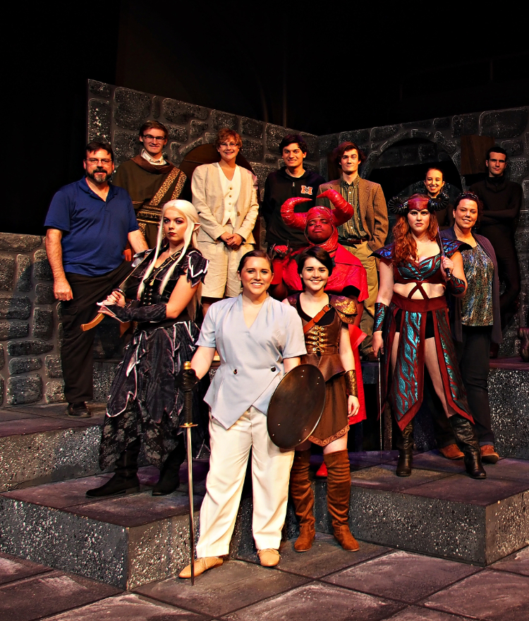 Mercer theatre cast in a group photo on stage