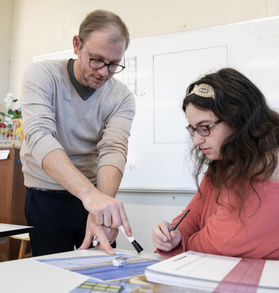 A professor works with a student