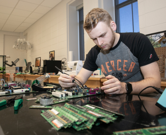 A student works with computer parts
